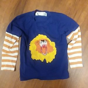 Blue and orange striped long sleeve lion shirt
